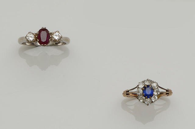 A sapphire and diamond cluster ring and a three stone ruby and diamond ring  (2)