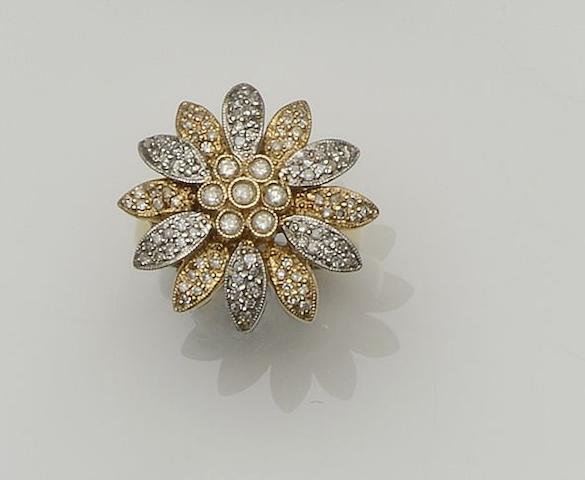 A diamond set flowerhead cluster ring