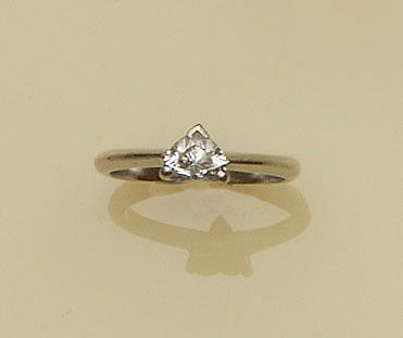 A single stone heart-shaped diamond ring