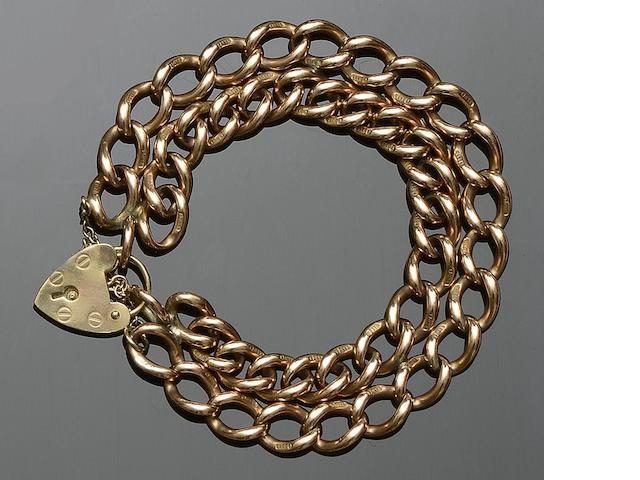 A 9ct gold curb-link bracelet and a yellow precious metal ropetwist necklace (2)