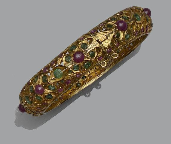 An Eastern ruby and emerald hinged bangle inner diameter approximately 5.8cm.