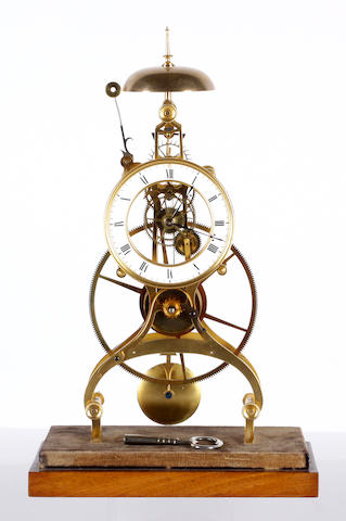 A Victorian style brass skeleton clock