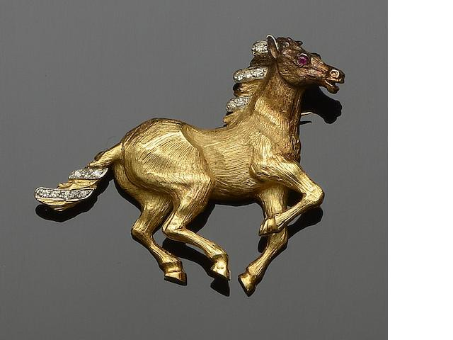 An 18ct gold diamond set galloping horse brooch