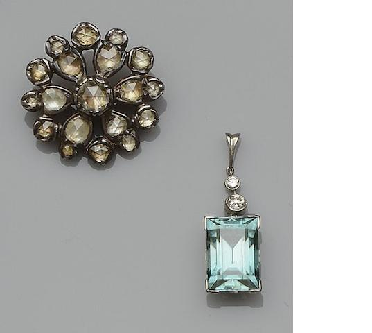 A Georgian diamond cluster brooch and a blue zircon and diamond pendant (2)