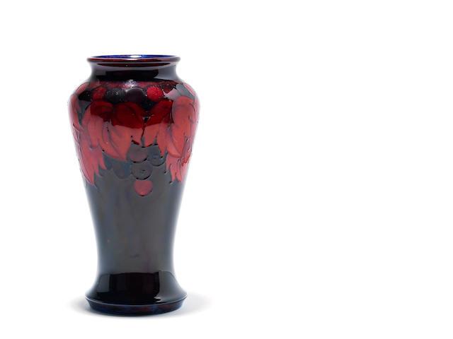 A William Moorcroft 'Leaf and Berry' flambé vase  Circa 1930