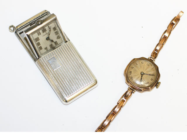 A lady's 9ct gold wristwatch and a Vertex travel watch,