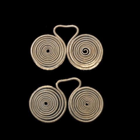 Two Geometric European silver spectacle fibulae 2