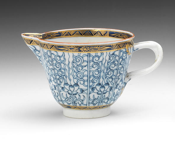 A very rare Cuaghley creamer, entwined handle, Royal Lily pattern, A Caughley jug of similar shape, corrugated neck, gilded decoration, and a Caughley jug, similar shape, fruit sprays