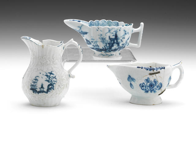 A Lowestoft creamboat, circa 1765-70, A Lowestoft IH moulded jug, simple blue panels (chip and crack), An English porcelain small boat, floral panels, poss. Isleworth (broken and riveted)