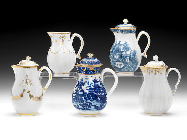 Five jugs, four with covers.