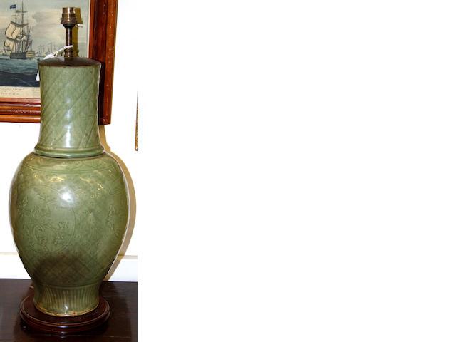 An incised celadon baluster vase,