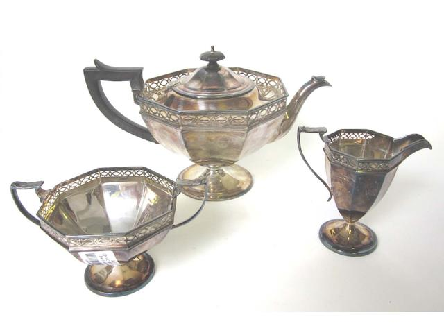 A George V silver 3 piece tea service by Sibray, Hall & Co, London 1912, together with salver and caster (5)