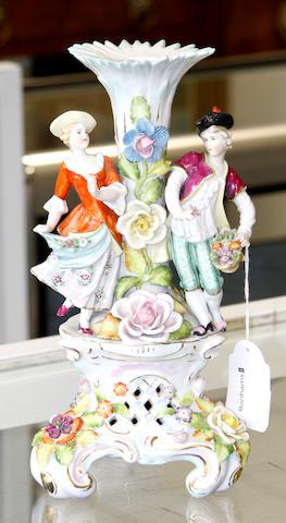 A German porcelain figural pedestal,