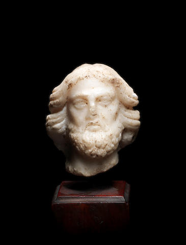 A small Hellenistic marble head of Asklepios