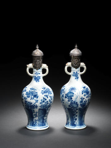 A pair of porcelain Ewers