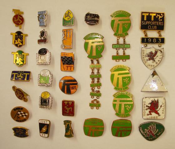 A collection of Isle of Man TT enamel lapel badges,