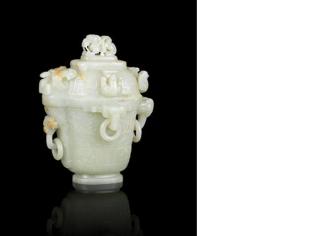 A fine and rare white jade archaistic pouring vessel and cover, guang 18th/19th century