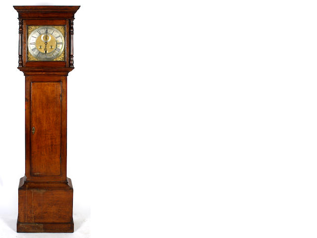 An oak longcase clock
