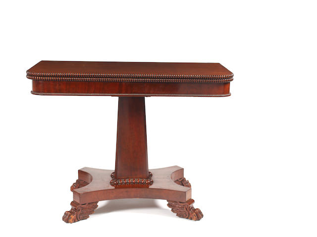 A George IV mahogany fold over tea table