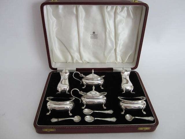 A silver six piece condiment set by Garrard & Co, Birmingham, 1964