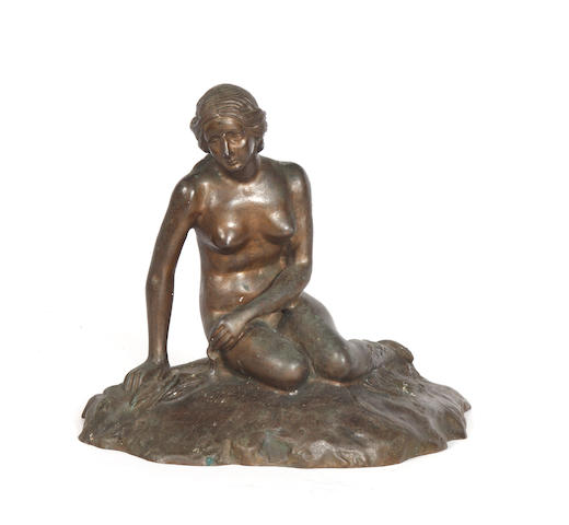 A bronze of a mermaid