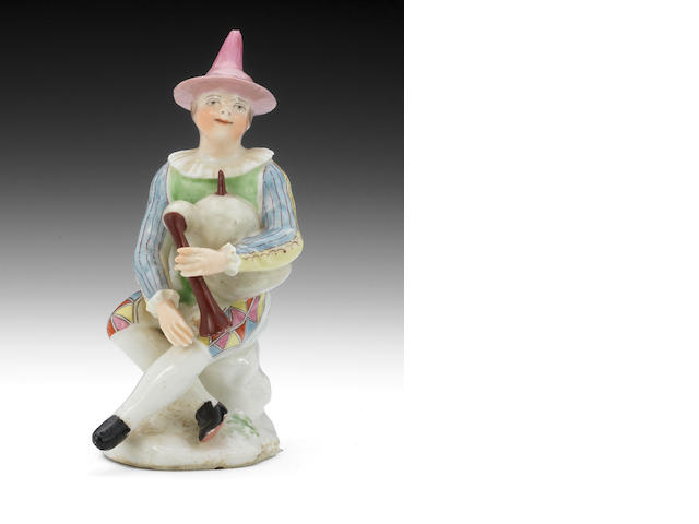 A rare West Pans figure of Harlequin as a bagpiper, circa 1764-70