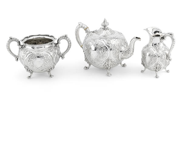 A Victorian silver three piece tea service by Robert Hennell, London 1865