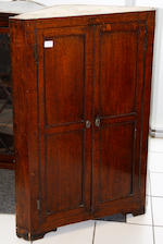 An early 19th Century oak standing corner cupboard,