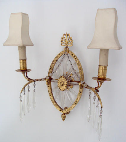 A pair of gilt metal and cut glass twin branch wall lights
