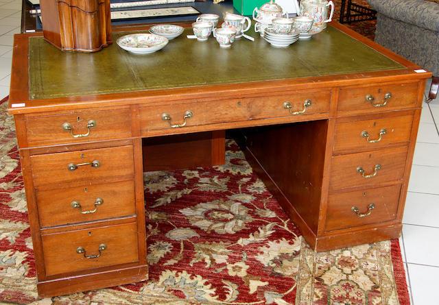 A Victorian-style mahogany pedestal desk