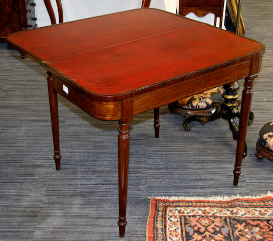 A George III mahogany 'D' shaped fold-over card table