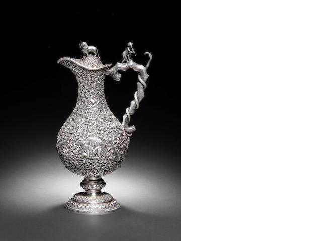 A repousse silver Claret Jug by Oomersi Mawji Bhuj, circa circa 1890-1910