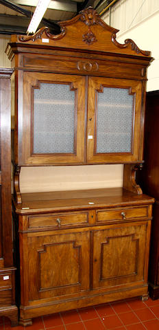 A late 19th Century Continetnal walnut cabinet bookcase,