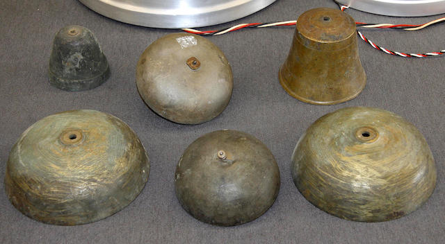 A collection of clock bells of varying sizes