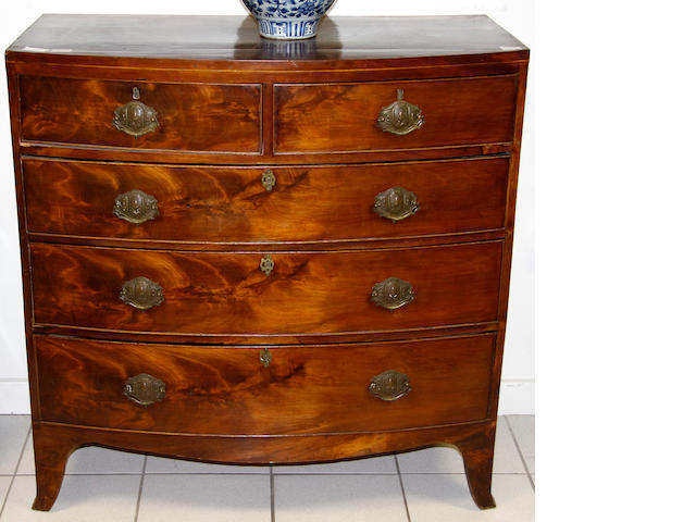 An early 19th Century mahogany bow fronted chest