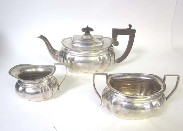 A silver three-piece tea service by Alexander Clark & Co ltd, Birmingham 1926, teapot 1935, and other items (Qty)