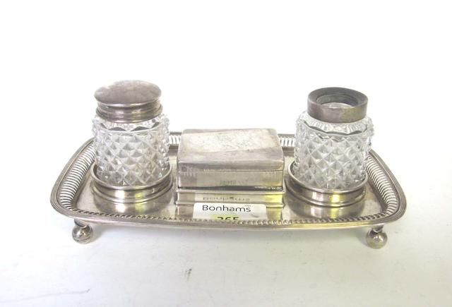 A Victorian silver inkstand, by Charles Stuart Harris, London 1891, another inkstand and a magnifying glass. (3)