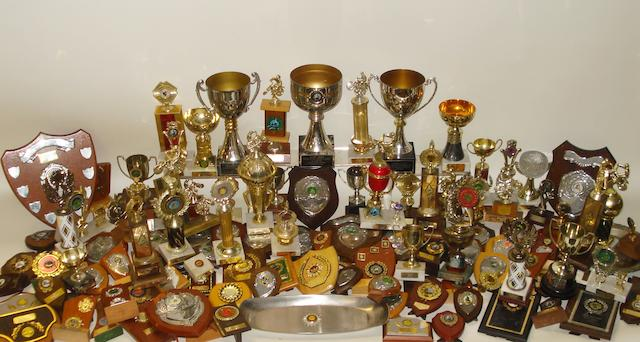 A large collection of John Hulme's??? club racing trophies, awards and shields,