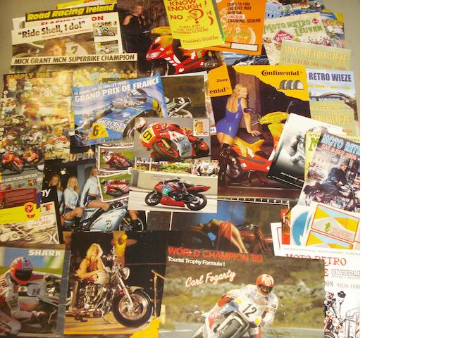 A quantity of assorted motorcycling posters,