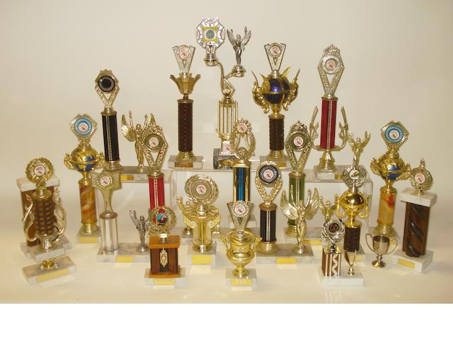 A collection of Kenny Shepherd's??? club racing trophies,