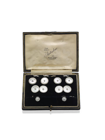 An early 20th century mother of pearl and diamond dress set