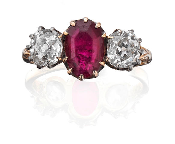 A ruby and diamond three-stone ring