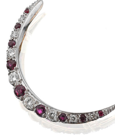 A ruby and diamond crescent brooch