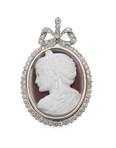 A hardstone cameo and diamond pendant