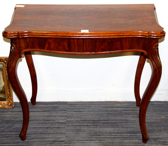 A mid-Victorian figured mahogany card table,