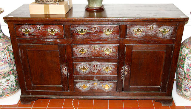 An oak sideboard or low dresser,