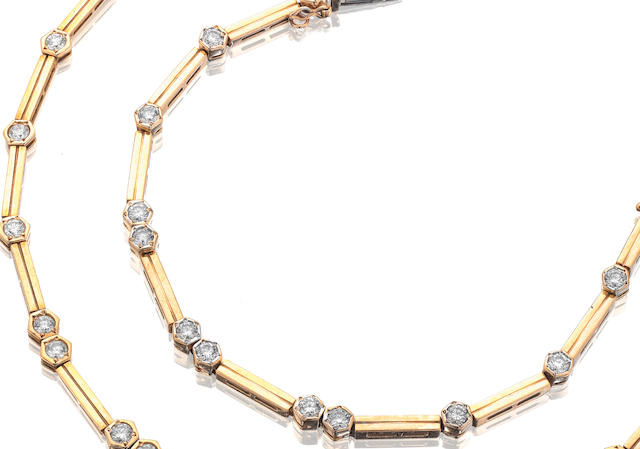 An 18ct gold diamond necklace and bracelet en suite
