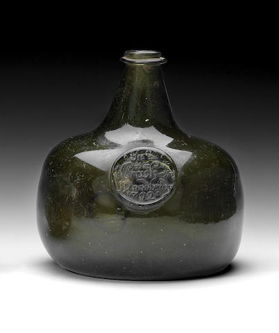 A previously unrecorded sealed wine bottle, dated 1702