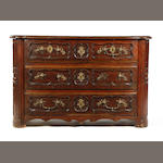 A Louis XV carved oak commode