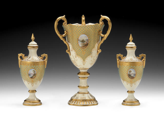 A Coalport jewelled goblet by Edward Ball and a pair of vases and covers, circa 1895-1900